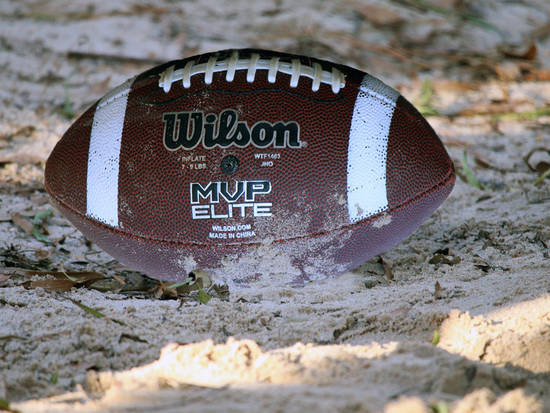 Upside Football in sand