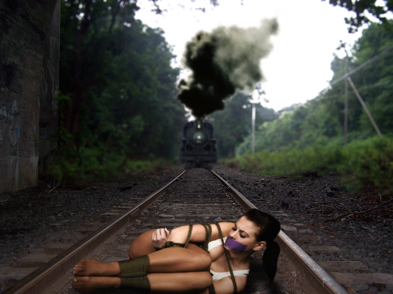 Thanks Girl tied to tracks